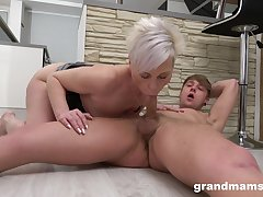 Auntie sucks the young dick then rides it firmly