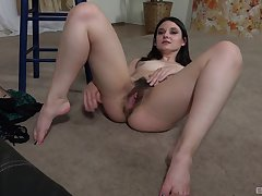Skinny solo chick takes off her panties to atom her hairy pussy