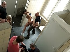 Long haired college babe Natalie Hot fucked in a restroom orgy