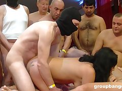 Black haired slut with red lipstick cum sprayed in a threesome