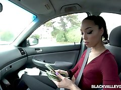 Slutty black chick Alexis Tae gives a blowjob in the car for money