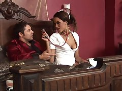 Keisha Kane wears costume for attend to and sits exceeding a hard shaft exceeding the bed