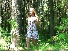 Bush-leaguer skinny young chick squats down and pisses in the forest
